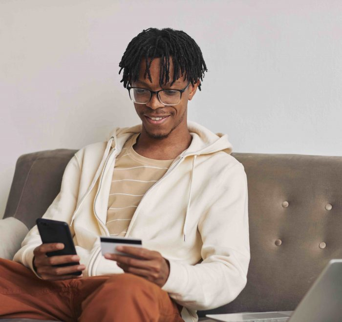 Man paying taxes online to GRA